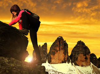 Girl on rock, in the background Tre Cime di Lavaredo