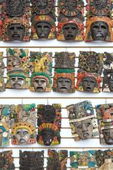 Mayan woodeMayan wooden handcrafted masks on the street market