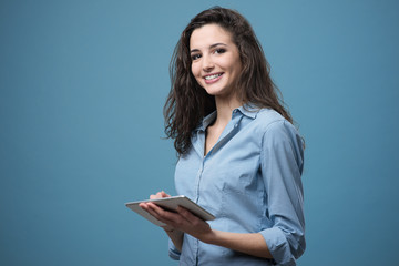 Beautiful smiling girl with tablet