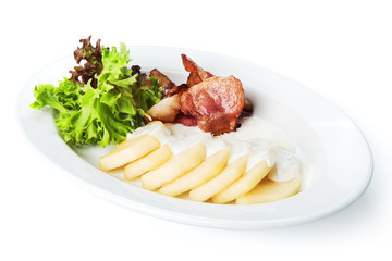 Restaurant food isolated - fried bacon with sliced pear and bech
