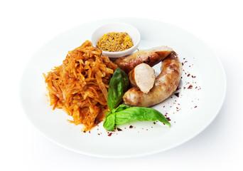 Restaurant food isolated - german sausages with braised sauerkra