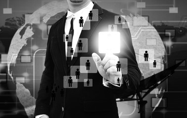 Businessman works with Social Network Display