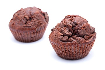 Two chocolate muffins on a white background.