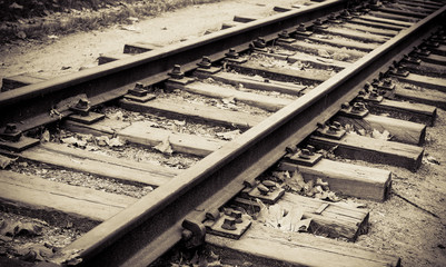 Railroad tracks on retro style for travel background.