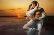 Couple in love at sunset - 77065431
