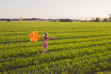 happy girl with balloons outdoor
