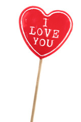heart shaped lolly pop on white background