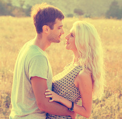 Couple in love summer flower field sunset