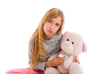 blond girl with teddy bear thermometer and flu