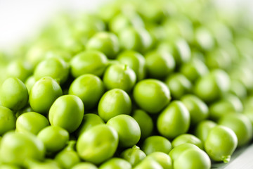 Peas. Green background. Soft focus