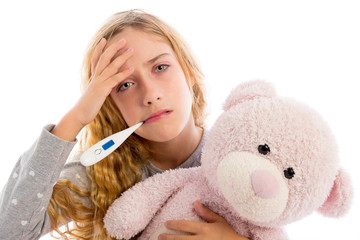 blond girl with thermometer and flu cold in pyjama