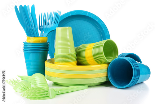 Bright plastic disposable tableware isolated on white - 77068473