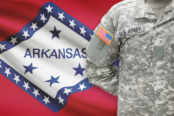 American soldier with US state flag on background - Arkansas