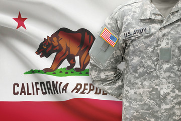 American soldier with US state flag on background - California