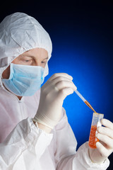 Lab worker testing a sample