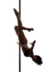 Young woman exercise pole dance, in shadow