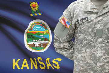 American soldier with US state flag on background - Kansas