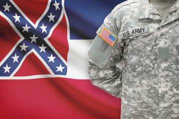 American soldier with US state flag on background - Mississippi