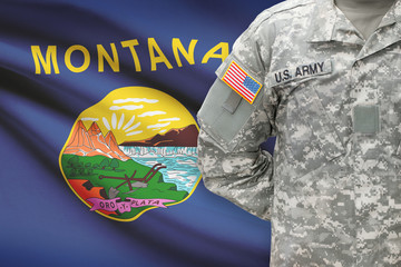 American soldier with US state flag on background - Montana