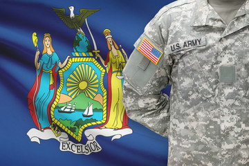 American soldier with US state flag on background - New York