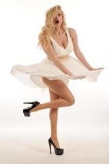 beautiful blonde woman wearing white dress