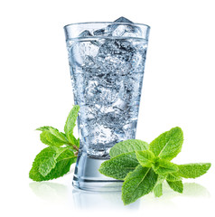 Glass of mineral carbonated water with ice.