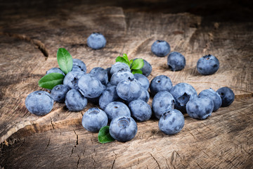 Blueberry with leaves on wood