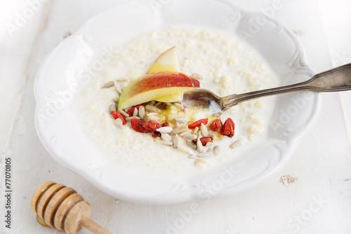 millet porridge with milk,goji berries, apple, honey and seeds - 77070805