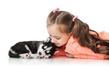 Girl with a sleeping puppy husky