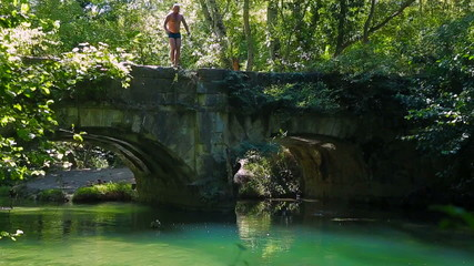 Slow-Mo. Man Jumping Into The River