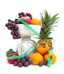 ripe fresh fruit, kitchen scale and measuring tape isolated on a