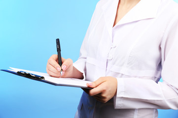 Doctor working with documents