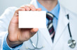 Doctor holding a blank business card