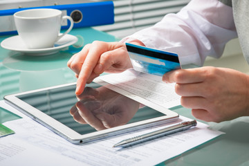 Shopping online with tablet and credit card