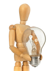 Wooden dummy that maintains a light bulb in hand