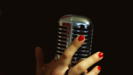 Music microphone female hands touch