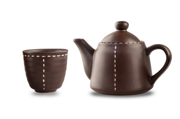 brown teapot and cup on the white backgroup