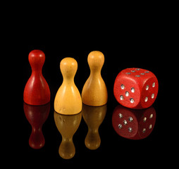 Yellow figures, red figures and playing dice on black background