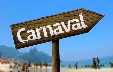 Carnaval wooden sign on the beach