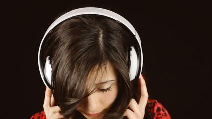 Music woman black headphones eye serious