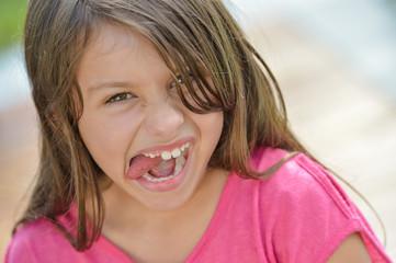Smiling Young Girl Tongue