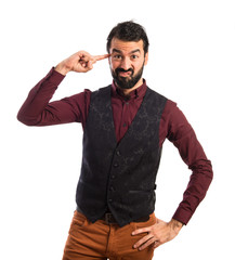Man wearing waistcoat making crazy gesture