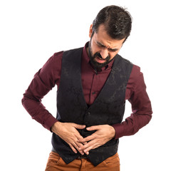 Man wearing waistcoat with stomachache