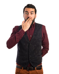 Man wearing waistcoat doing surprise gesture