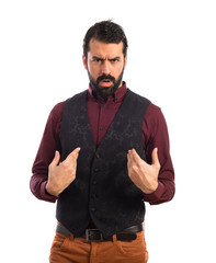 Man wearing waistcoat doing surprise gesture