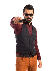Man wearing waistcoat shooting with a pistol