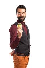 Man wearing waistcoat holding a cactus
