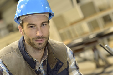 Portrait of industrial engineer wearing safety helmet