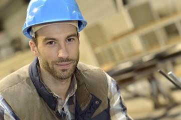 Portrait of industrial engineer wearing safety helmet