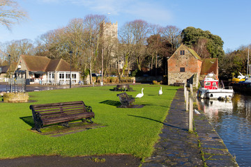 Christchurch Dorset UK by river with seats and church